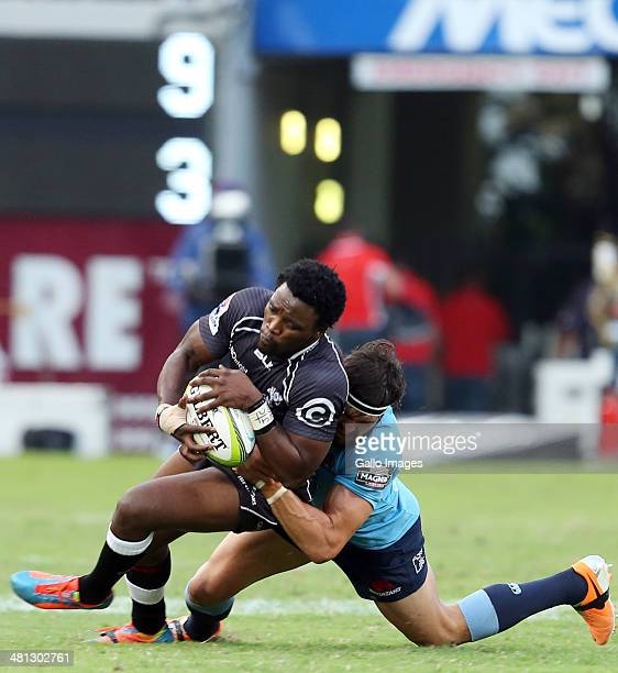 Lwazi Mvovo of the Cell C Sharks is tackled by Adam AshleyCooper of the Waratahs during the Super Rugby match between Cell C Sharks and Waratahs at...