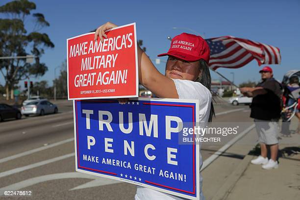 Ly Kou joins supporters of US Presidentelect Donald Trump during a streetside rally in front of Marine Corps Base Camp Pendleton in Oceanside...