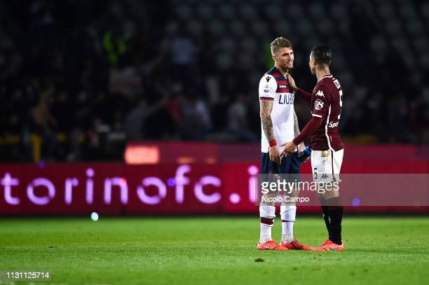 Lynco of Bologna FC and Armando Izzo of Torino FC speak at the end of the Serie A football match between Torino FC and Bologna FC Bologna FC won 32...
