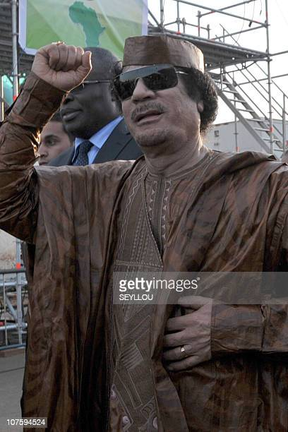 Lybian head of state Mouammar Kadhafi gestures during the World Festival of Black Arts and Culture in Dakar on December 14 2010 held at the Monument...