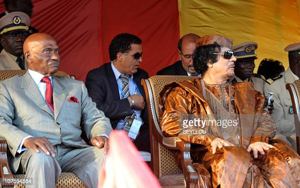 Lybian head of state Mouammar Kadhafi sits with Senegal's President Abdoulaye Wade during the World Festival of Black Arts and Culture in Dakar on...
