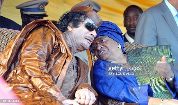 Lybian head of state Mouammar Kadhafi speak with Liberian President Ellen Johnson Sirleafe during the World Festival of Black Arts and Culture in...