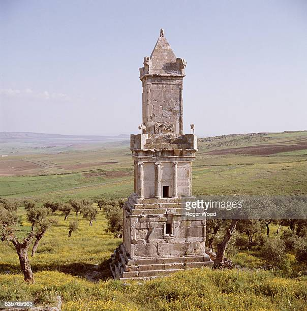 Lybico-Punic mausoleum stands at the site of Dougga, overlooking rolling farmland in the hills of northern Tunisia. It dates from the Punic period in...