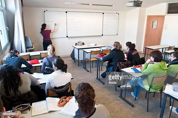 Lycee Philibert Dessaignes secondary / high school in Blois Maths lesson teacher writing on the blackboard classroom