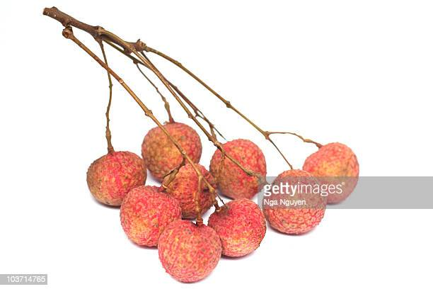 Lychees against white background