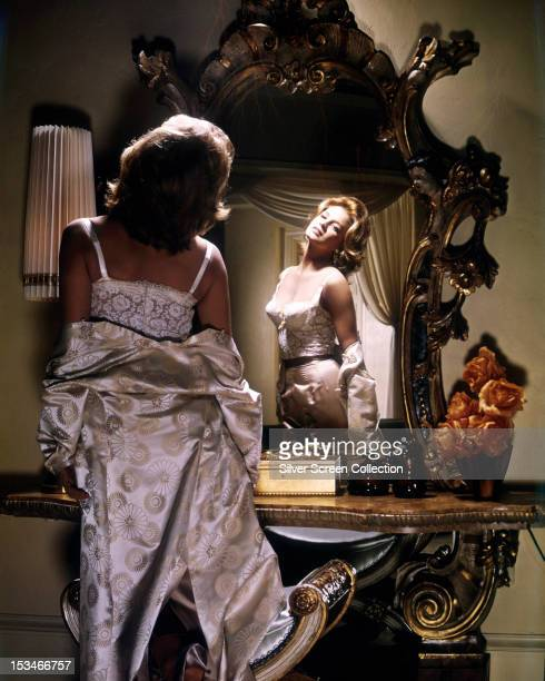 Lyda Kent played by American actress Angie Dickinson disrobes in front of a mirror in 'Rome Adventure' directed by Delmer Daves 1962