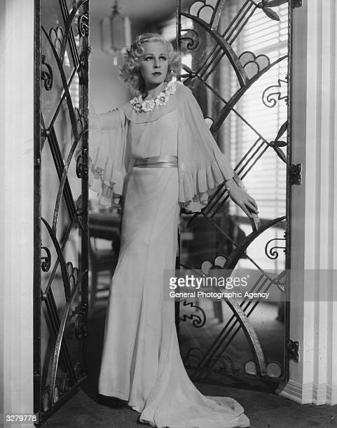 Lyda Roberti the GermanPolish leading lady and star of 'The Big Broadcast of 1936' She is wearing a white georgette crepe hostess gown