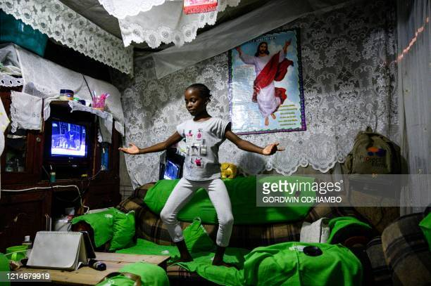 Lydia Akoth a member of Project Elimu practice dancing on a sofa at home during a distant ballet lesson via a mobile phone due to the COVID19...