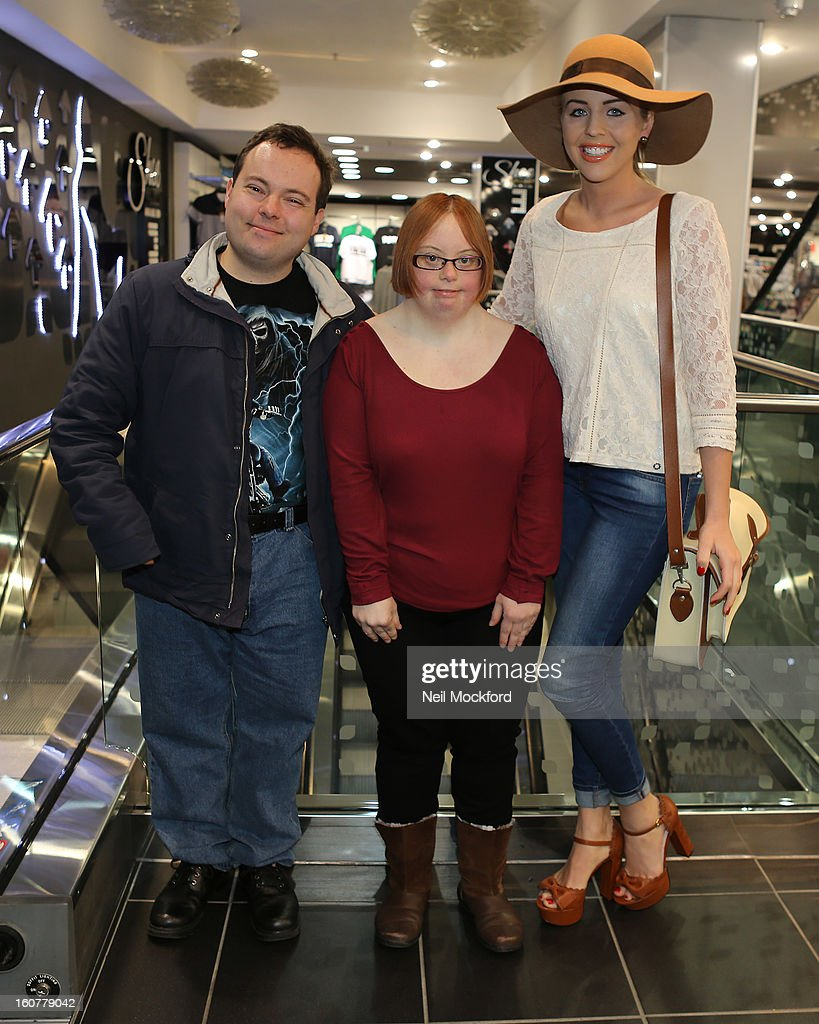Lydia Bright (R) gives Simon Macgregor (L) and Kate Brackley (C) from 'The Undateables' a makeover at New Look, Oxford St on February 5, 2013 in London, England.