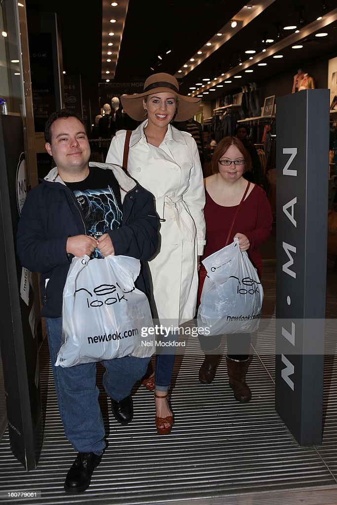 Lydia Bright (C) gives Simon Macgregor (L) and Kate Brackley from 'The Undateables' a makeover at New Look, Oxford St on February 5, 2013 in London, England.