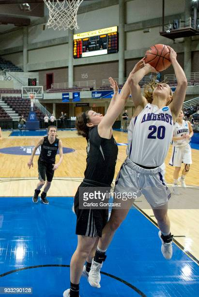 Lydia Caputi of Amherst College attempted a shot during the Division III Women's Basketball Championship held at the Mayo Civic Center on March 17...
