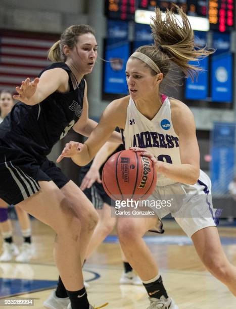 Lydia Caputi of Amherst College dribbled up the court during the Division III Women's Basketball Championship held at the Mayo Civic Center on March...