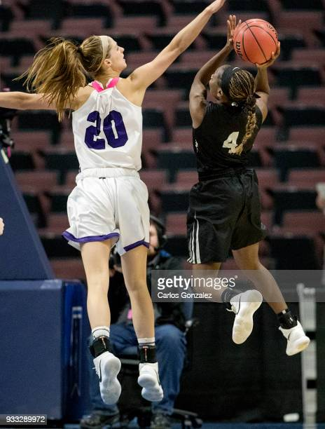 Lydia Caputi of Amherst defended Taylor Choate of Bowdoin during the Division III Women's Basketball Championship held at the Mayo Civic Center on...
