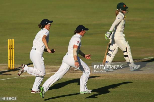 Lydia Greenway and Arran Brindle of England celebrate the dismissal of Jodie Fields of Australia during day three of the Women's Ashes Test match...