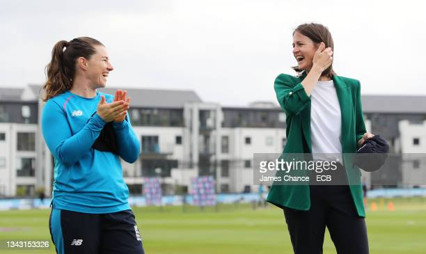 Lydia Greenway speaks to Tammy Beaumont of England as she is awarded her Kent Cap prior to the 5th One Day International match between England and...
