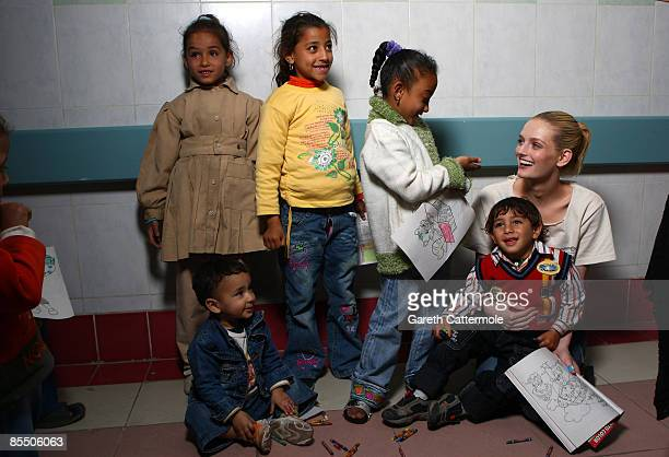 Lydia Hearst plays with children before surgery during an Operation Smile mission at a Cairo Hospital on March 8, 2009 in Cairo, Egypt. Operation...