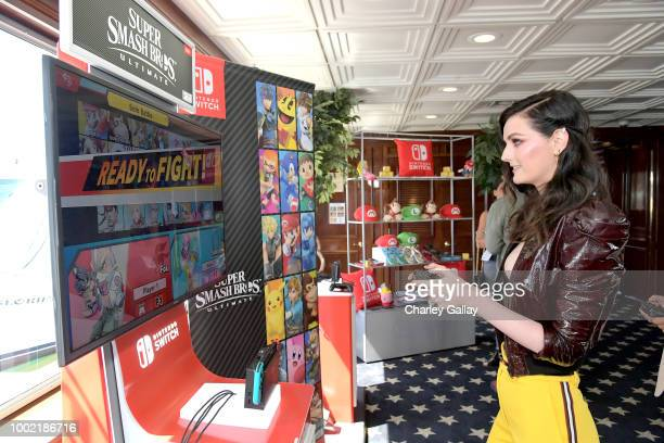 Lydia Hearst tests her skills on Super Smash Bros Ultimate for Nintendo Switch at the Variety Studio at ComicCon 2018 on July 19 2018 in San Diego...