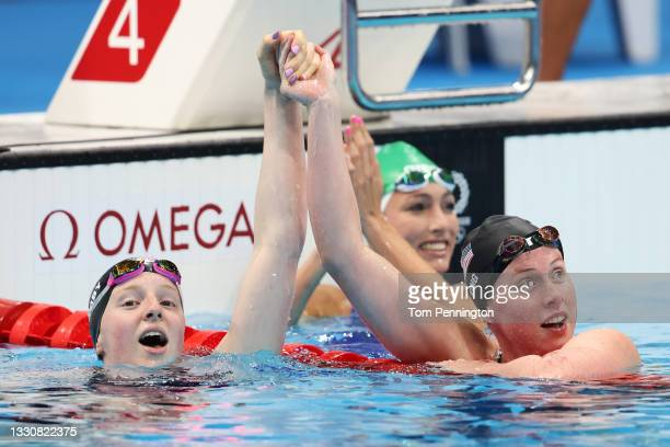 Lydia Jacoby of Team United States, Tatjana Schoenmaker of Team South Africa and Lilly King of Team United States celebrate after winning the gold,...
