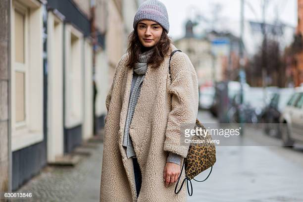Lydia Kleiber wearing a creme wool coat Monki blue denim jeans with patch from Monki cashmere knit sweater mint berry a leopard print other stories...