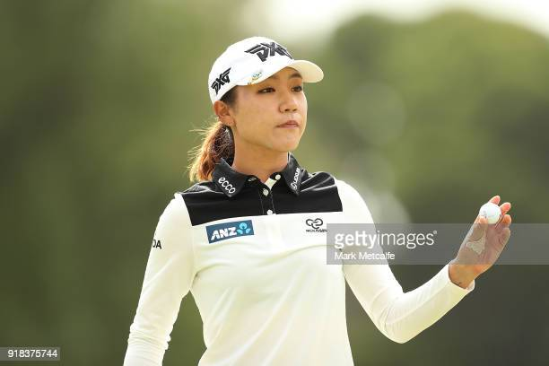 Lydia Ko of New Zealand acknowledges the crowd after holing a putt during day one of the ISPS Handa Australian Women's Open at Kooyonga Golf Club on...