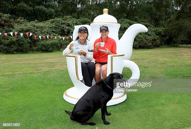 Lydia Ko of New Zealand and Brittany Lang of the United States attend a traditional English tea party hosted by Charley Hull of England at a...