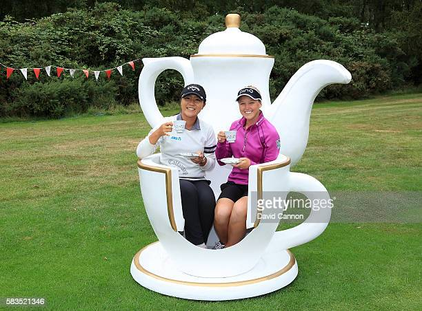 Lydia Ko of New Zealand and Brooke Henderson of Canada attend a traditional English tea party hosted by Charley Hull of England at a photocall during...
