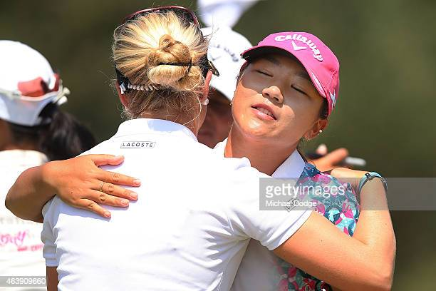 Lydia Ko of New Zealand and Charley Hull of England hug after finishing their round at the 18th hole during day one of the LPGA Australian Open at...