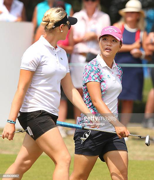 Lydia Ko of New Zealand and Charley Hull of England talk up the first hole during day one of the LPGA Australian Open at Royal Melbourne Golf Course...