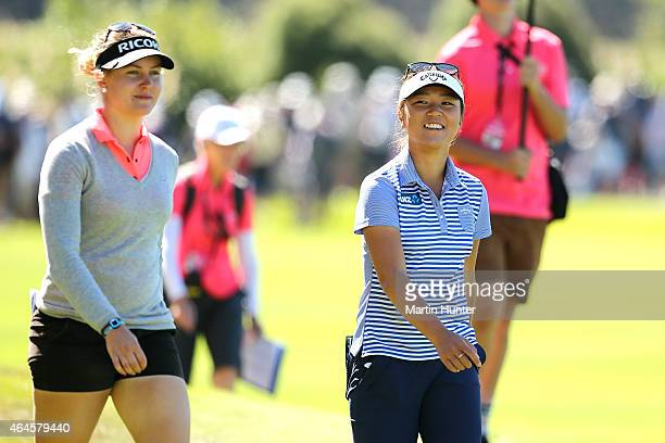 Lydia Ko of New Zealand and Charley Hull of England walk down the 18th fairway during day one of the ISPS Handa New Zealand Women's Open at...