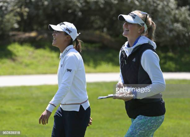 Lydia Ko of New Zealand and Jessica Korda talk on the third hole during the final round of the Mediheal Championship at Lake Merced Golf Club on...