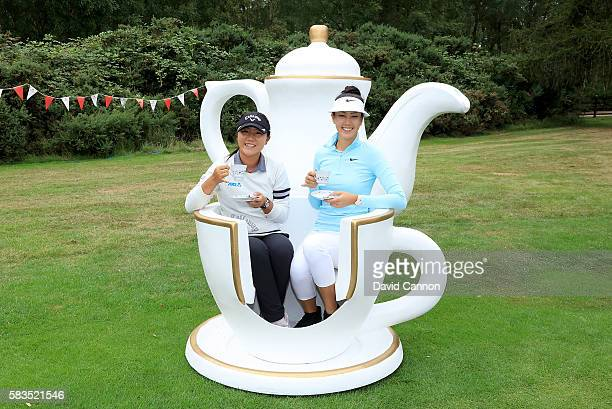Lydia Ko of New Zealand and Michelle Wie of the United States attend a traditional English tea party hosted by Charley Hull of England at a photocall...