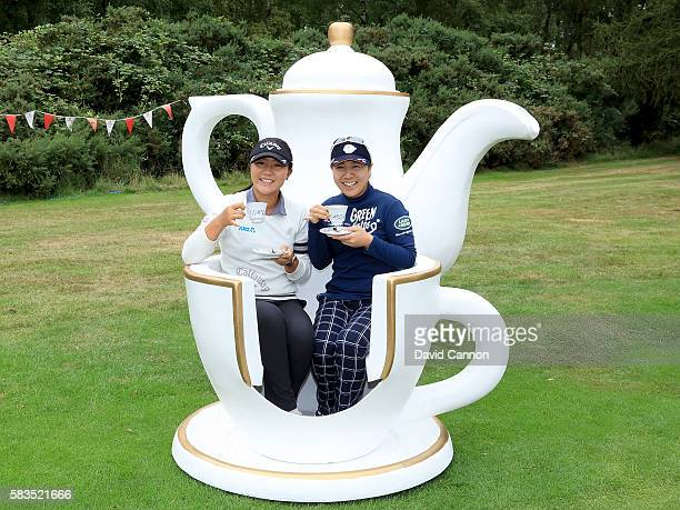 Lydia Ko of New Zealand and Mika Miyazato of Japan attend a traditional English tea party hosted by Charley Hull of England at a photocall during a...