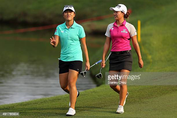 Lydia Ko of New Zealand and Minjee Lee of Australia walks to the 18th hole during round one of the Sime Darby LPGA Tour at Kuala Lumpur Golf Country...