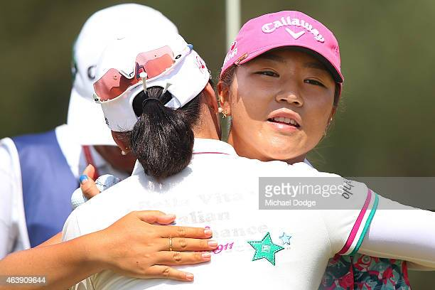 Lydia Ko of New Zealand and So Yeon Ryu of South Korea hug after finishing their round at the 18th hole during day one of the LPGA Australian Open at...