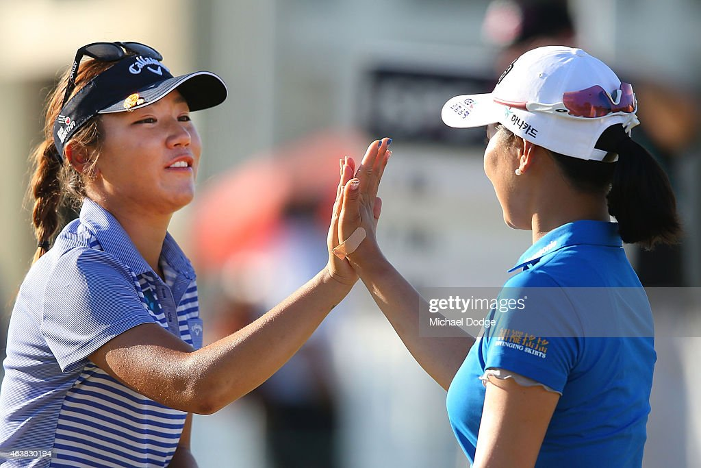 Lydia Ko of New Zealand (L) and So Yeon Ryu of South Korea reacts after finishing their round at the 18th hole during day one of the LPGA Australian Open at Royal Melbourne Golf Course on February 19, 2015 in Melbourne, Australia.
