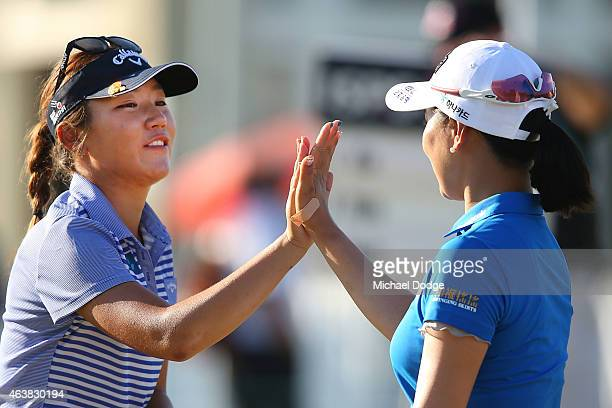 Lydia Ko of New Zealand and So Yeon Ryu of South Korea reacts after finishing their round at the 18th hole during day one of the LPGA Australian Open...
