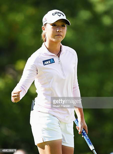 Lydia Ko of New Zealand celebrates on the 17th hole during the final round of the Evian Championship Golf on September 13 2015 in EvianlesBains France