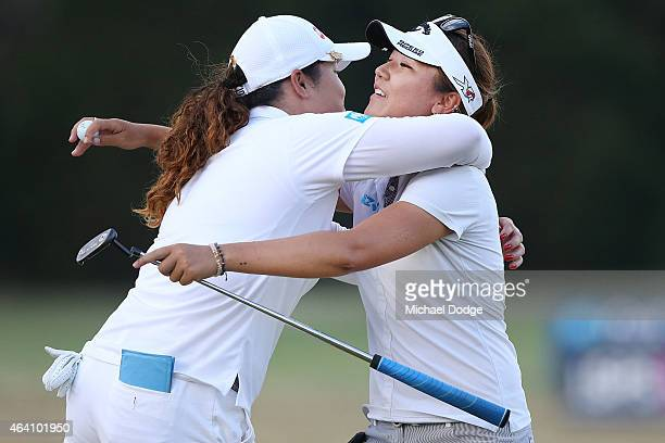 Lydia Ko of New Zealand celebrates victory and hugs Ariya Jutanugarn of Thailandafter her putt on the 18th hole during day four of the LPGA...