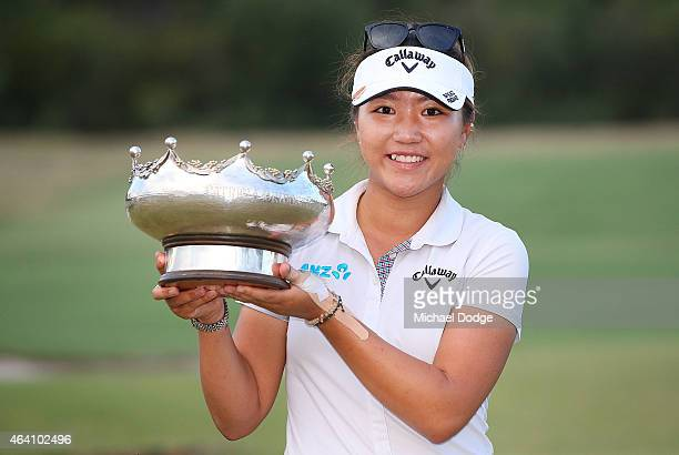 Lydia Ko of New Zealand celebrates victory and lifts the Patricia Bridges Bowl trophy at the presentation during day four of the LPGA Australian Open...