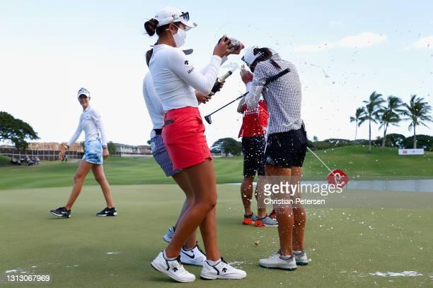 Lydia Ko of New Zealand celebrates with Yealimi Noh after winning the LPGA LOTTE Championship at Kapolei Golf Club on April 17, 2021 in Kapolei,...