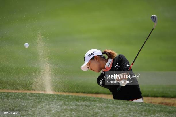Lydia Ko of New Zealand chips from the bunker onto the first green during the first round of the Bank Of Hope Founders Cup at Wildfire Golf Club on...