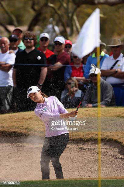 Lydia Ko of New Zealand chips from the bunker onto the ninth green during the second round of the Bank Of Hope Founders Cup at Wildfire Golf Club on...