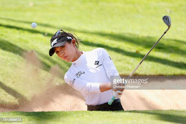 Lydia Ko of New Zealand chips out of the bunker onto the 17th green during the second round of the LPGA LOTTE Championship at Kapolei Golf Club on...