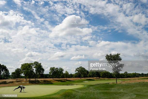 Lydia Ko of New Zealand grabs her ball after putting on the fourth green during the first round of the LPGA Drive On Championship at Inverness Club...