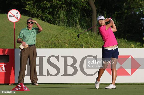 Lydia Ko of New Zealand hits a shot as her swing coach David Leadbetter looks on during the proam prior to the start of the HSBC Women's Champions at...