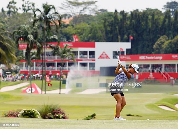 Lydia Ko of New Zealand hits her approach shot on the 16th hole during the third round of the HSBC Women's Champions at the Sentosa Golf Club on...