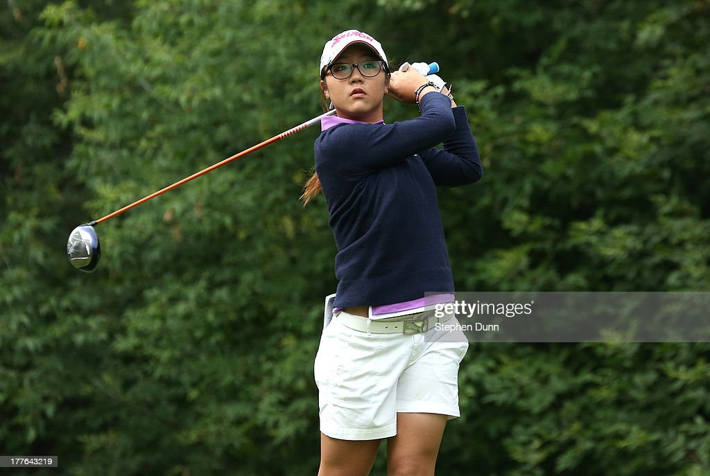 Lydia Ko of New Zealand hits her tee shot on the fifth hole during the final round of the CN Canadian Women's Open at Royal Mayfair Golf Club on August 25, 2013 in Edmonton, Alberta, Canada.