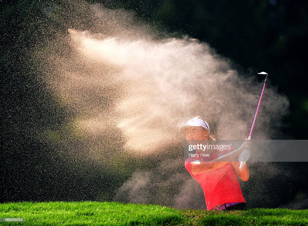 Lydia Ko of New Zealand hits out of the bunker on the fourth hole during the final round of the Canadian Pacific Women's Open at the Vancouver Golf Club on August 23, 2015 in Vancouver, Canada.