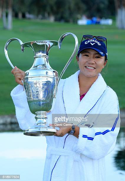 Lydia Ko of New Zealand holds thr trophy after the final round of the 2016 ANA Inspiration at the Mission Hills Country Club on April 3, 2016 in...