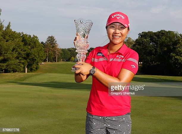 Lydia Ko of New Zealand holds up the championship trophy after winning the Marathon Classic presented by Owens Corning and O-I after four playoff...